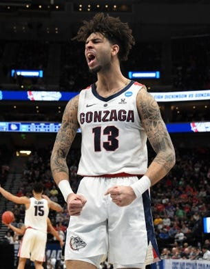 Mar 21, 2019; Salt Lake City, UT, USA; Gonzaga Bulldogs guard Josh Perkins (13) celebrates against the Fairleigh Dickinson Knights  in the first round of the 2019 NCAA Tournament at Vivint Smart Home Arena. Gonzaga defeated Farleigh Dickinson 87-49. Mandatory Credit: Kirby Lee-USA TODAY Sports