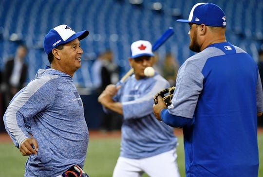 Mar 28, 2019; Toronto, Ontario, CAN;   Toronto Blue Jays manager Charlie Montoya (25) speaks with designated hitter Rowdy Tellez (44) as third base coach Luis Rivera (4) prepares to hit to infielders during fielding practice before playing Detroit Tigers at Rogers Centre. Mandatory Credit: Dan Hamilton-USA TODAY Sports