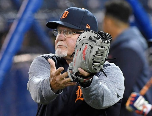 Mar 28, 2019; Toronto, Ontario, CAN; Detroit Tigers manager Ron Gardenhire (15) catches a ball during batting practice before playing Toronto Blue Jays at Rogers Centre. Mandatory Credit: Dan Hamilton-USA TODAY Sports