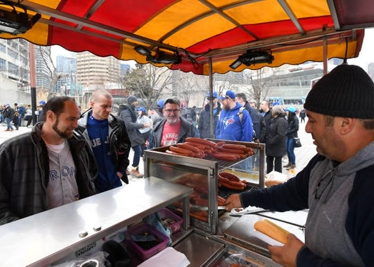 Mar 28, 2019; Toronto, Ontario, CAN;  Toronto Blue Jays fans line up for pre-game hot dogs before the home opener against Detroit Tigers at Rogers Centre. Mandatory Credit: Dan Hamilton-USA TODAY Sports