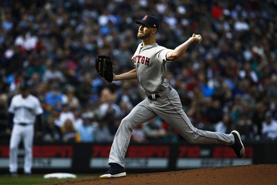 Mar 28, 2019; Seattle, WA, USA; Boston Red Sox starting pitcher Chris Sale (41) throws against the Seattle Mariners during the first inning at T-Mobile Park. Mandatory Credit: Joe Nicholson-USA TODAY Sports