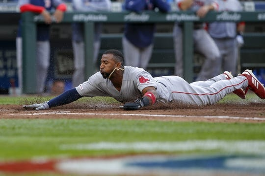 Mar 28, 2019; Seattle, WA, USA; Boston Red Sox third baseman Eduardo Nunez (36) scores a run against the Seattle Mariners during the second inning at T-Mobile Park. Mandatory Credit: Joe Nicholson-USA TODAY Sports