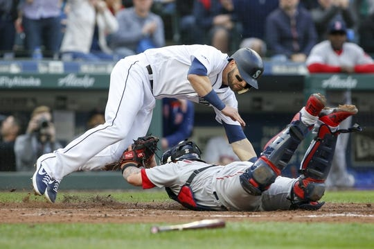 Mar 28, 2019; Seattle, WA, USA; Seattle Mariners right fielder Mitch Haniger (17) is tagged out by Boston Red Sox catcher Christian Vazquez (7) during the third inning at T-Mobile Park. Mandatory Credit: Joe Nicholson-USA TODAY Sports