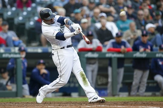 Mar 28, 2019; Seattle, WA, USA; Seattle Mariners shortstop Tim Beckham (1) hits a two-run home run against the Boston Red Sox during the third inning at T-Mobile Park. Mandatory Credit: Joe Nicholson-USA TODAY Sports