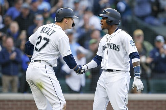 Mar 28, 2019; Seattle, WA, USA; Seattle Mariners shortstop Tim Beckham (1) is greeted by first baseman Ryon Healy (27) after hitting a two-run home run against the Boston Red Sox during the third inning at T-Mobile Park. Healy scored a run on the hit. Mandatory Credit: Joe Nicholson-USA TODAY Sports