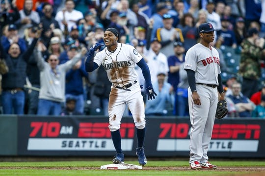 Mar 28, 2019; Seattle, WA, USA; Seattle Mariners center fielder Mallex Smith (0) celebrates after hitting a triple as Boston Red Sox third baseman Rafael Devers (right) looks on during the third inning at T-Mobile Park. Mandatory Credit: Joe Nicholson-USA TODAY Sports