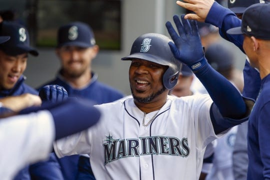 Mar 28, 2019; Seattle, WA, USA; Seattle Mariners designated hitter Edwin Encarnacion (10) is greeted in the dugout after hitting a solo home run against the Boston Red Sox during the fourth inning at T-Mobile Park. Mandatory Credit: Joe Nicholson-USA TODAY Sports