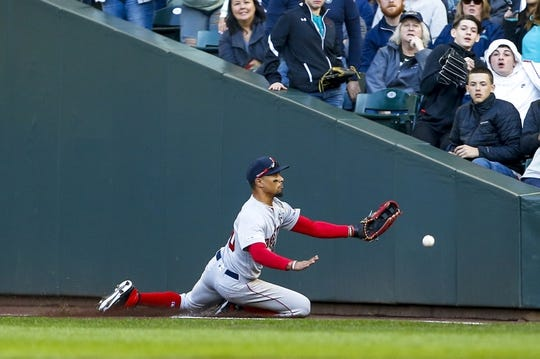 Mar 28, 2019; Seattle, WA, USA; Boston Red Sox right fielder Mookie Betts (50) cannot catch a foul ball against the Seattle Mariners during the sixth inning at T-Mobile Park. Mandatory Credit: Joe Nicholson-USA TODAY Sports
