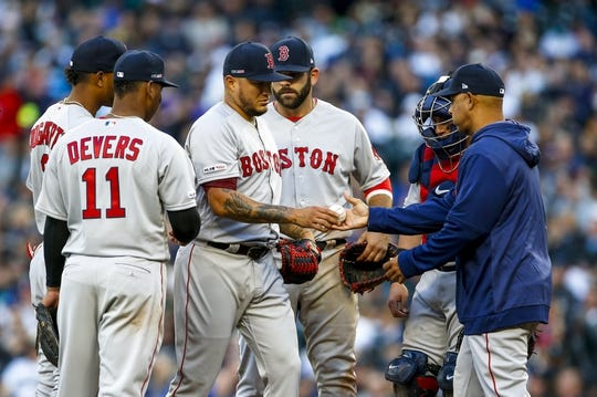 Mar 28, 2019; Seattle, WA, USA; Boston Red Sox starting pitcher Hector Velazquez (76) gives the ball to manager Alex Cora (20) after being relieved for against the Seattle Mariners during the sixth inning at T-Mobile Park. Mandatory Credit: Joe Nicholson-USA TODAY Sports