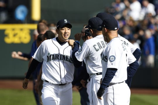 Mar 28, 2019; Seattle, WA, USA; Seattle Mariners starting pitcher Yusei Kikuchi (18) greets teammates during a pregame ceremony against the Boston Red Sox at T-Mobile Park. Mandatory Credit: Joe Nicholson-USA TODAY Sports