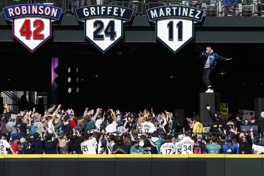 Mar 28, 2019; Seattle, WA, USA; Recording artist Macklemore performs in the center field beer garden before a game between the Boston Red Sox and Seattle Mariners at T-Mobile Park. Mandatory Credit: Joe Nicholson-USA TODAY Sports
