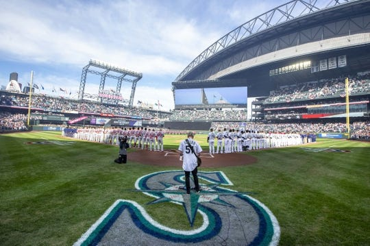 Mar 28, 2019; Seattle, WA, USA; Pearl Jam guitarist Mike McCready performs the national anthem before a game between the Boston Red Sox and Seattle Mariners at T-Mobile Park. Mandatory Credit: Joe Nicholson-USA TODAY Sports