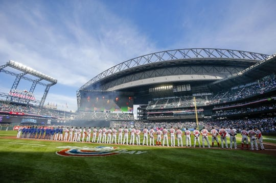 Mar 28, 2019; Seattle, WA, USA; Boston Red Sox players and staff stand on the field during a pregame ceremony against the Seattle Mariners at T-Mobile Park. Mandatory Credit: Joe Nicholson-USA TODAY Sports