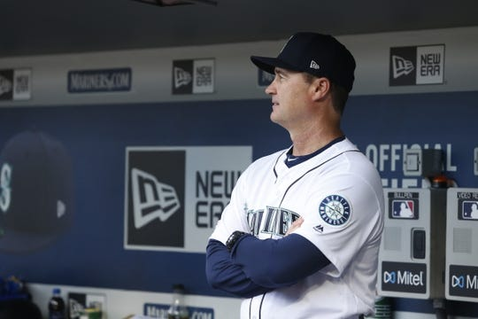 Mar 28, 2019; Seattle, WA, USA; Seattle Mariners manager Scott Servais (29) stands in the dugout during a pregame ceremony against the Boston Red Sox at T-Mobile Park. Mandatory Credit: Joe Nicholson-USA TODAY Sports