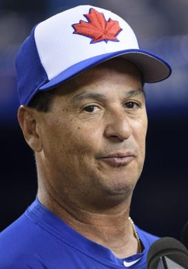 Mar 29, 2019; Toronto, Ontario, CAN; Toronto Blue Jays manager Charlie Montoyo (25) talks with the media during batting practice against the Detroit Tigers at Rogers Centre. Mandatory Credit: Nick Turchiaro-USA TODAY Sports