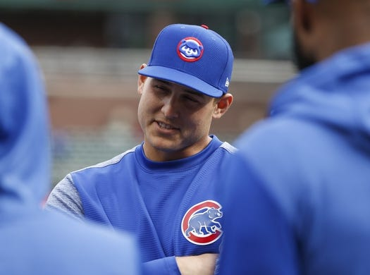 Mar 30, 2019; Arlington, TX, USA; Chicago Cubs first baseman Anthony Rizzo speaks to teammates during team warmups before a baseball game against the Texas Rangers at Globe Life Park in Arlington. Mandatory Credit: Jim Cowsert-USA TODAY Sports