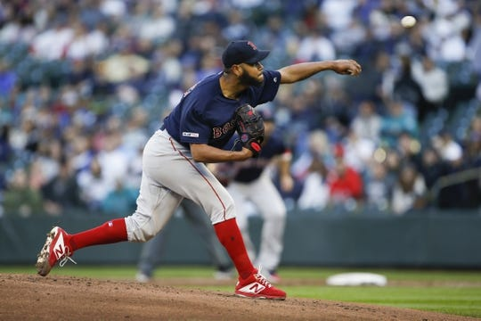 Mar 30, 2019; Seattle, WA, USA; Boston Red Sox starting pitcher Eduardo Rodriguez (57) throws against the Seattle Mariners during the first inning at T-Mobile Park. Mandatory Credit: Joe Nicholson-USA TODAY Sports
