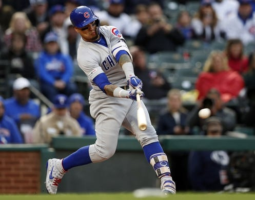 Mar 30, 2019; Arlington, TX, USA; Chicago Cubs shortstop Javier Baez (9) hits for an RBI single against the Texas Rangers during the first inning in a baseball game at Globe Life Park in Arlington. Mandatory Credit: Jim Cowsert-USA TODAY Sports
