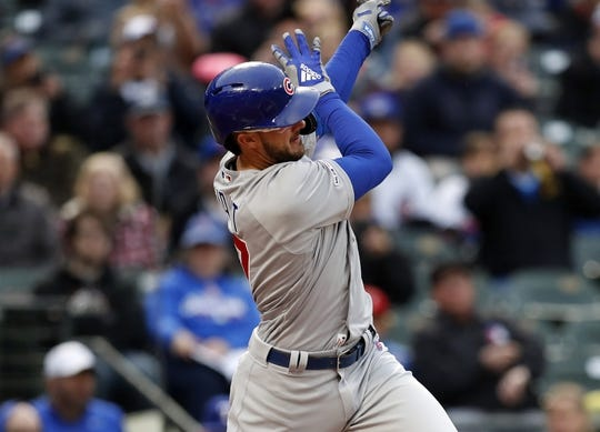 Mar 30, 2019; Arlington, TX, USA; Chicago Cubs left fielder Kris Bryant (17) follows through on his double against the Texas Rangers during the first inning in a baseball game at Globe Life Park in Arlington. Mandatory Credit: Jim Cowsert-USA TODAY Sports
