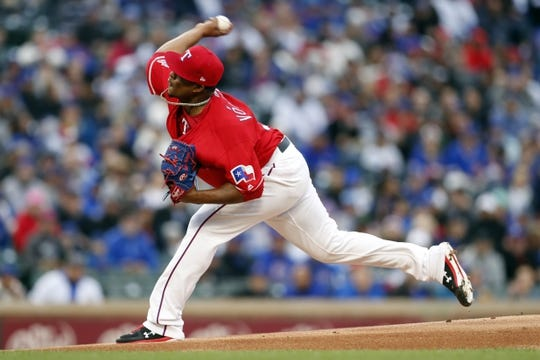 Mar 30, 2019; Arlington, TX, USA; Texas Rangers starting pitcher Edinson Volquez (36) delivers a pitch to a Chicago Cubs batter during the first inning in a baseball game at Globe Life Park in Arlington. Mandatory Credit: Jim Cowsert-USA TODAY Sports
