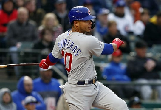 Mar 30, 2019; Arlington, TX, USA; Chicago Cubs catcher Willson Contreras (40) follows through on his RBI single against the Texas Rangers during the first inning in a baseball game at Globe Life Park in Arlington. Mandatory Credit: Jim Cowsert-USA TODAY Sports