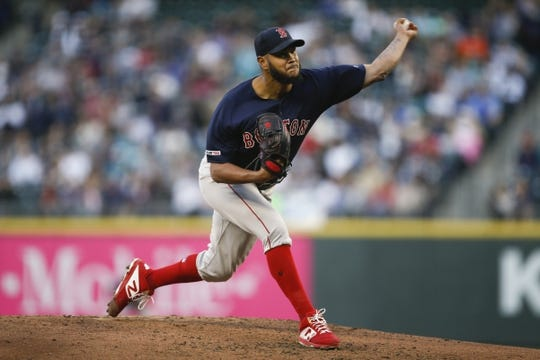 Mar 30, 2019; Seattle, WA, USA; Boston Red Sox starting pitcher Eduardo Rodriguez (57) throws against the Seattle Mariners during the second inning at T-Mobile Park. Mandatory Credit: Joe Nicholson-USA TODAY Sports