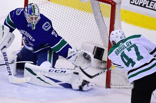 Mar 30, 2019; Vancouver, British Columbia, CAN; Vancouver Canucks goaltender Jacob Markstrom (25) blocks a shot on net by Dallas Stars forward Alexander Radulov (47) during the first period at Rogers Arena. Mandatory Credit: Anne-Marie Sorvin-USA TODAY Sports