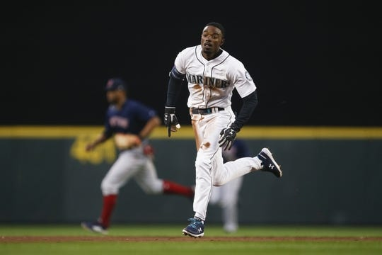 Mar 30, 2019; Seattle, WA, USA; Seattle Mariners second baseman Dee Gordon (9) advances to third on a throwing error against the Boston Red Sox during the fourth inning at T-Mobile Park. Mandatory Credit: Joe Nicholson-USA TODAY Sports
