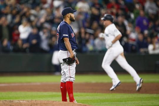 Mar 30, 2019; Seattle, WA, USA; Boston Red Sox relief pitcher Heath Hembree (37) reacts after surrendering a three-run home run to Seattle Mariners first baseman Jay Bruce (32, background) during the fifth inning at T-Mobile Park. Mandatory Credit: Joe Nicholson-USA TODAY Sports