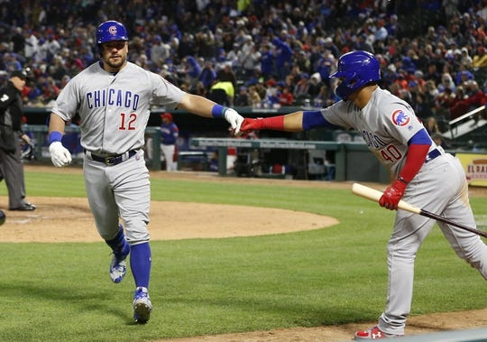 Mar 30, 2019; Arlington, TX, USA; Chicago Cubs designated hitter Kyle Schwarber (12) is congratulated by catcher Willson Contreras (40) as he after he scores on his home run against the Texas Rangers during the fifth inning in a baseball game at Globe Life Park in Arlington. Mandatory Credit: Jim Cowsert-USA TODAY Sports