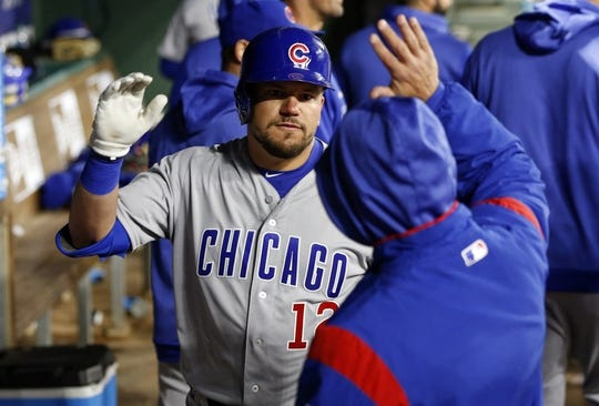 Mar 30, 2019; Arlington, TX, USA; Chicago Cubs designated hitter Kyle Schwarber (12) is congratulated by teammates on his home run against the Texas Rangers during the fifth inning in a baseball game at Globe Life Park in Arlington. Mandatory Credit: Jim Cowsert-USA TODAY Sports