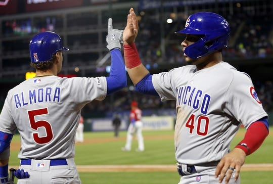 Mar 30, 2019; Arlington, TX, USA; Chicago Cubs catcher Willson Contreras (40) is congratulated by center fielder Albert Almora Jr. (5) after scoring during the fifth inning in a baseball game against the Texas Rangers at Globe Life Park in Arlington. Mandatory Credit: Jim Cowsert-USA TODAY Sports