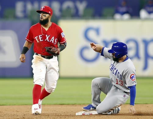 Mar 30, 2019; Arlington, TX, USA; Texas Rangers second baseman Rougned Odor (12) looks after forcing out Chicago Cubs third baseman David Bote (13) during the fifth inning in a baseball game at Globe Life Park in Arlington. Mandatory Credit: Jim Cowsert-USA TODAY Sports