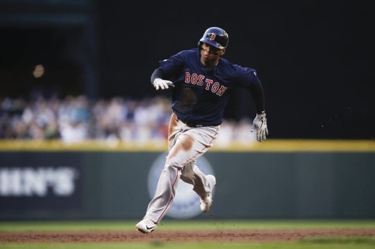 Mar 30, 2019; Seattle, WA, USA; Boston Red Sox third baseman Rafael Devers (11) rounds third to score a run against the Seattle Mariners during the third inning at T-Mobile Park. Mandatory Credit: Joe Nicholson-USA TODAY Sports