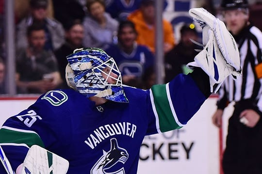 Mar 30, 2019; Vancouver, British Columbia, CAN; Vancouver Canucks goaltender Jacob Markstrom (25) makes a glove save against a shot on net by the Dallas Stars during the second period at Rogers Arena. Mandatory Credit: Anne-Marie Sorvin-USA TODAY Sports