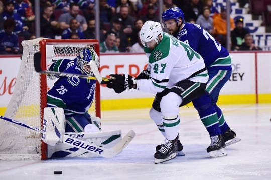 Mar 30, 2019; Vancouver, British Columbia, CAN; Vancouver Canucks defenseman Alexander Edler (23) and goaltender Jacob Markstrom (25) defend against Dallas Stars forward Alexander Radulov (47) during the second period at Rogers Arena. Mandatory Credit: Anne-Marie Sorvin-USA TODAY Sports