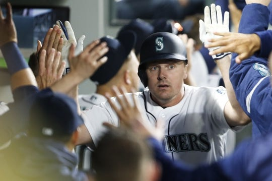Mar 30, 2019; Seattle, WA, USA; Seattle Mariners first baseman Jay Bruce (32) is greeted in the dugout after hitting a three-run home run against the Boston Red Sox during the fifth inning at T-Mobile Park. Mandatory Credit: Joe Nicholson-USA TODAY Sports