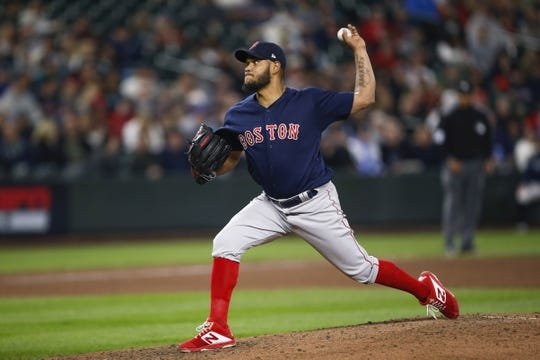 Mar 30, 2019; Seattle, WA, USA; Boston Red Sox starting pitcher Eduardo Rodriguez (57) throws against the Seattle Mariners during the fifth inning at T-Mobile Park. Mandatory Credit: Joe Nicholson-USA TODAY Sports