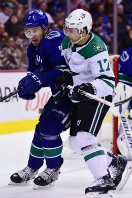 Mar 30, 2019; Vancouver, British Columbia, CAN; Vancouver Canucks defenseman Luke Schenn (2) defends against Dallas Stars forward Andrew Cogliano (17) during the second period at Rogers Arena. Mandatory Credit: Anne-Marie Sorvin-USA TODAY Sports