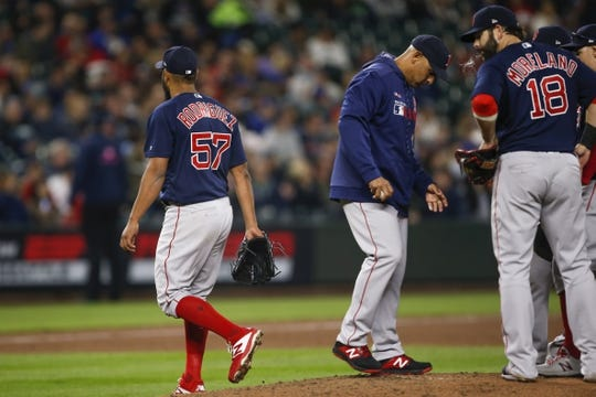 Mar 30, 2019; Seattle, WA, USA; Boston Red Sox starting pitcher Eduardo Rodriguez (57) walks to the dugout after being relieved for by manager Alex Cora (middle) during the fifth inning against the Seattle Mariners at T-Mobile Park. Mandatory Credit: Joe Nicholson-USA TODAY Sports