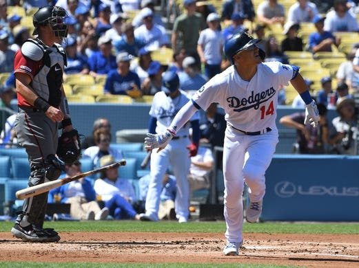 Mar 31, 2019; Los Angeles, CA, USA; Arizona Diamondbacks catcher Carson Kelly (18) looks on as Los Angeles Dodgers center fielder Enrique Hernandez (14) hits a sacrifice fly in the first inning at Dodger Stadium. Mandatory Credit: Jayne Kamin-Oncea-USA TODAY Sports
