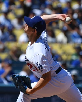Mar 31, 2019; Los Angeles, CA, USA; Los Angeles Dodgers starting pitcher Walker Buehler (21) pitches in the first inning against the Arizona Diamondbacks at Dodger Stadium. Mandatory Credit: Jayne Kamin-Oncea-USA TODAY Sports