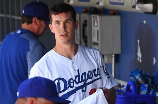 Mar 31, 2019; Los Angeles, CA, USA; Los Angeles Dodgers starting pitcher Walker Buehler (21) looks on from the dugout after the second inning against the Arizona Diamondbacks at Dodger Stadium. Mandatory Credit: Jayne Kamin-Oncea-USA TODAY Sports