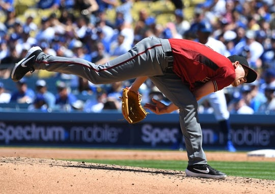 Mar 31, 2019; Los Angeles, CA, USA; Arizona Diamondbacks starting pitcher Luke Weaver (24) pitches in the second inning against the Los Angeles Dodgers at Dodger Stadium. Mandatory Credit: Jayne Kamin-Oncea-USA TODAY Sports