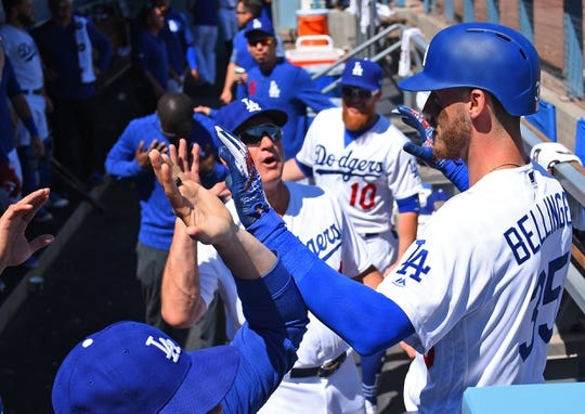 Mar 31, 2019; Los Angeles, CA, USA; Los Angeles Dodgers center fielder Cody Bellinger (35) is greeted in the dugout after hitting a solo home run in the third inning against the Arizona Diamondbacks at Dodger Stadium. Mandatory Credit: Jayne Kamin-Oncea-USA TODAY Sports