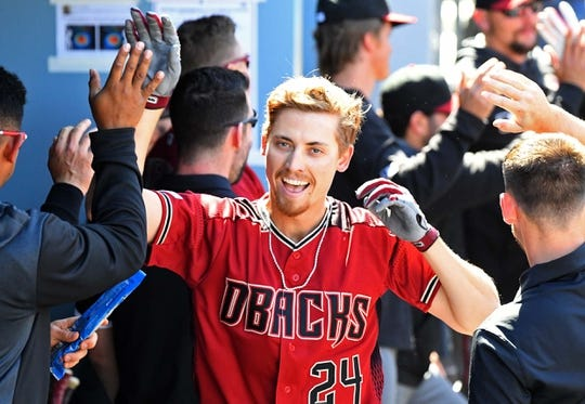 Mar 31, 2019; Los Angeles, CA, USA; Arizona Diamondbacks starting pitcher Luke Weaver (24) is greeted in the dugout after hitting a solo home run in the fourth inning of the game at Dodger Stadium. Mandatory Credit: Jayne Kamin-Oncea-USA TODAY Sports