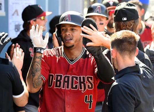 Mar 31, 2019; Los Angeles, CA, USA; Arizona Diamondbacks shortstop Ketel Marte (4) is greeted in the dugout after scoring a run in the fourth inning of the game at Dodger Stadium. Mandatory Credit: Jayne Kamin-Oncea-USA TODAY Sports
