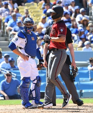 Mar 31, 2019; Los Angeles, CA, USA; Los Angeles Dodgers catcher Russell Martin (55) looks on as Arizona Diamondbacks starting pitcher Luke Weaver (24) crosses the plate after hitting a solo home run in the fourth inning of the game at Dodger Stadium. Mandatory Credit: Jayne Kamin-Oncea-USA TODAY Sports