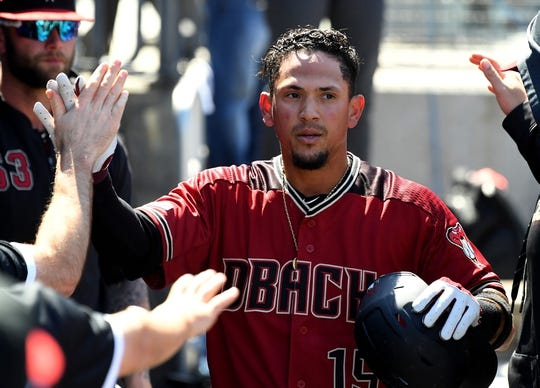 Mar 31, 2019; Los Angeles, CA, USA;    Arizona Diamondbacks second baseman Ildemaro Vargas (15) is greeted in the dugout after scoring a run against the Los Angeles Dodgers in the fourth inning at Dodger Stadium. Mandatory Credit: Jayne Kamin-Oncea-USA TODAY Sports