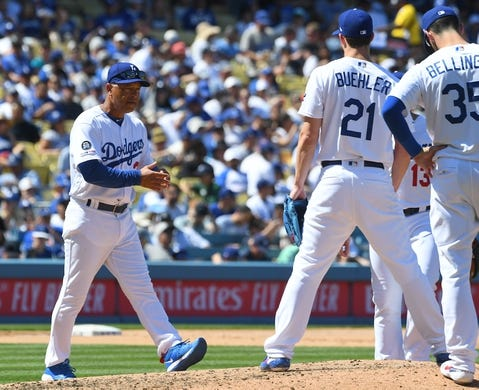 Mar 31, 2019; Los Angeles, CA, USA; Los Angeles Dodgers manager Dave Roberts (30) walks to the mound to pull starting pitcher Walker Buehler (21) in the fourth inning against the Arizona Diamondbacks at Dodger Stadium. Mandatory Credit: Jayne Kamin-Oncea-USA TODAY Sports